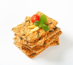 Whole grain crackers with cheddar and pepitas